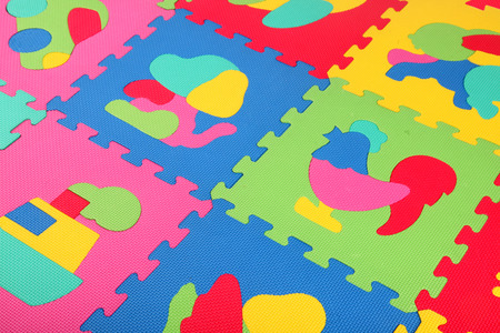 pink dolphin: Multicolored foam puzzle a white background Stock Photo