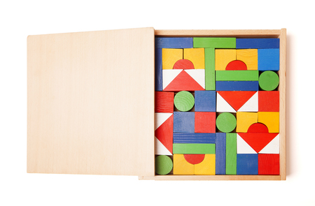 many hands: wooden box with many blocks on white background