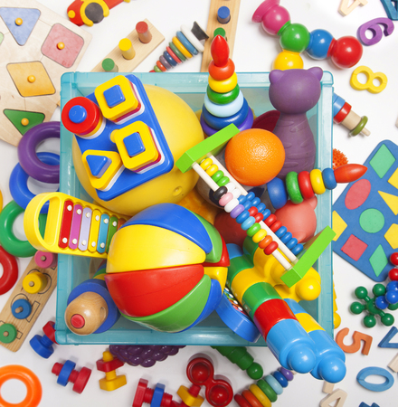 box with toys on the white