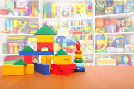 baby toys: color blocks on the floor in a playroom