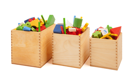 Three wooden boxes with very many toys Standard-Bild