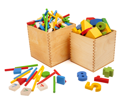Two wooden boxes with very many toys