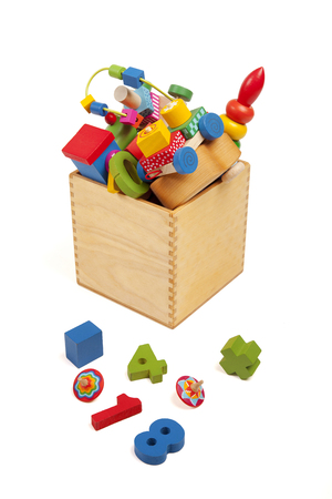 Box with very many toys on the while background