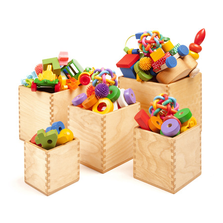Five wooden boxes with very many toys