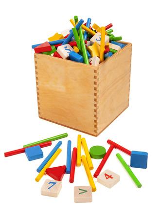 Wooden box with very many toys Stockfoto