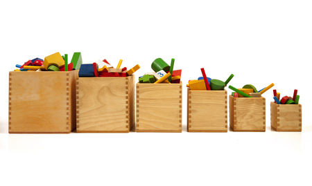 Six wooden boxes with very many toys Stockfoto