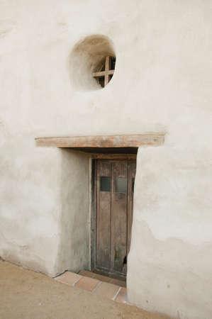 Adobe structure with wood door