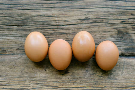 Top view of 4 randomly aligned eggs on a farm table