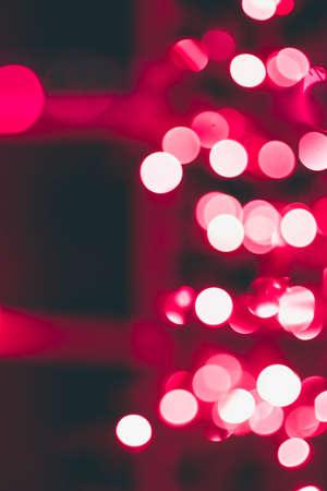 Red Christmas light bokeh create a magical setting Stock Photo