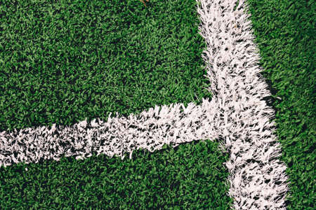 White lines painted on artificial grass on a soccer field