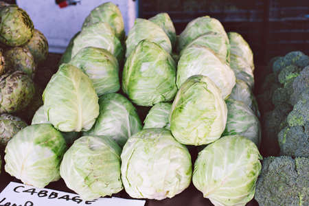 Selling cabbage at a market stall at the farmers market