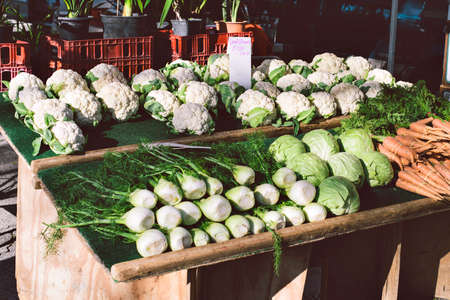 Colorful array of vegetables for sale on a wood stand in a farmers market Stock Photo