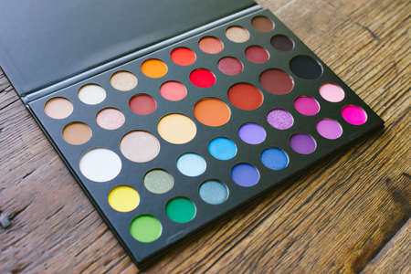 Eye shadow palette with an array of colors and circular shapes