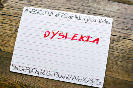 Capital letters in red spell Dyslexia on a penmanship board Stock Photo