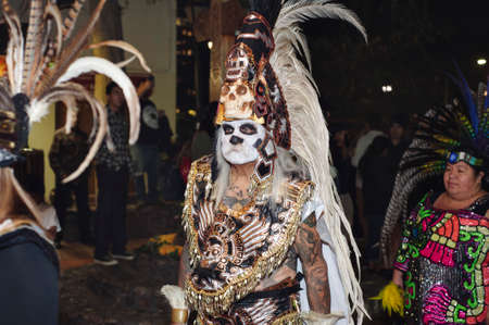 Los Angeles, California/USA - October 30, 2019: A man dressed in traditional Indigenous attire participates in the Dia de los Muertos celebration at Olvera Street Editorial