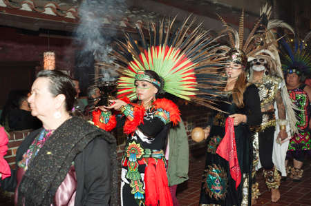 Los Angeles, California/USA - October 30, 2019: Celebrants dressed in traditional Indigenous attire walk in a Day of the Dead Procession at Olvera Street Editorial