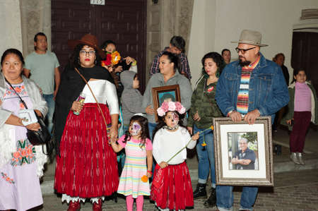 Los Angeles, California/USA - October 30, 2019: A family honors a loved one at the Day of the Dead Celebration at the Olvera Street celebration
