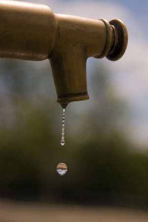 A tap dripping water photo