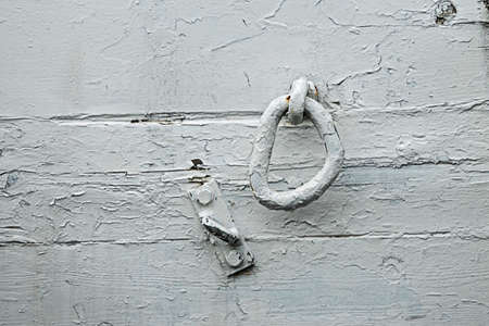 Texture background white painted wooden wall with iron ring