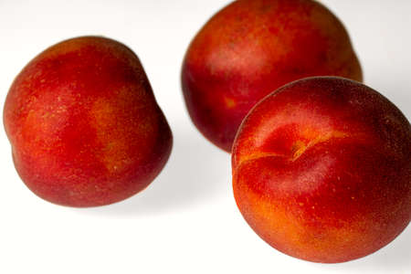 3 apricots isolated against bright background Stok Fotoğraf