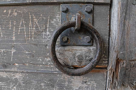 Sturdy iron ring on old wooden door Banco de Imagens