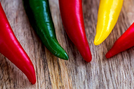 Chilli peppers on wooden background Stock Photo