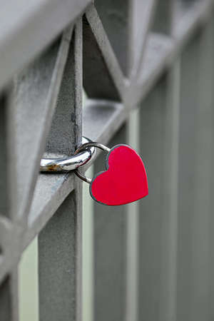 Heart shaped safety lock on a bridge railing sign of love Stock Photo - 130132268