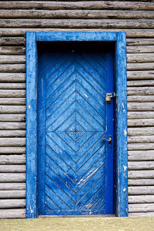 Old blue painted wooden door on a barn