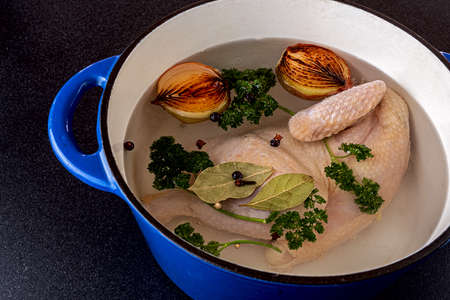 Healthy chicken soup ready for cooking Banco de Imagens