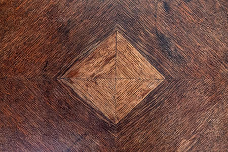 Texture background wooden board, dark brown wood with inlaid light brown square
