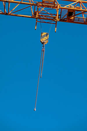 Section of a crane with a steel chain attached to it