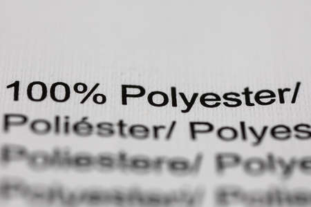 100 percent polyester printed on a label in clothing Stockfoto