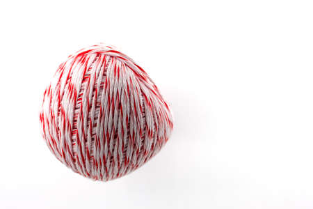 red and white striped yarn for preparing meat in the kitchen, barding meat with bacon for example