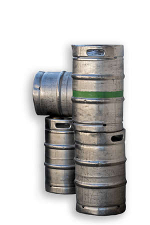 four silver-colored metal beer barrels, one with a green ring around it Stockfoto