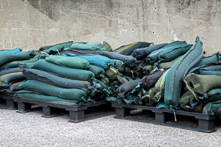 stacked sandbags to protect against flooding