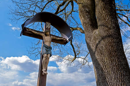 frequent sight in Bavaria, Jesus on the cross, carved sculpture on the wayside