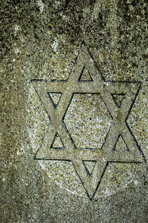 Side view of a Star of David carved into a tombstone by a stonemason