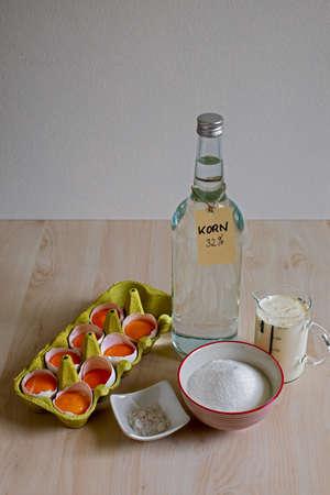 ingredients for making egg liqueur, corn schnapps, egg yolks, cream, sugar and vanilla sugar ingredients for making egg liqueur