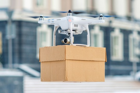 Drone is a great tool for delivering packages. Banco de Imagens - 50319564
