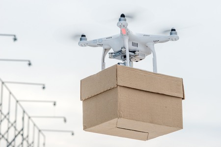 eshop: Drone is a great tool for delivering packages. Stock Photo