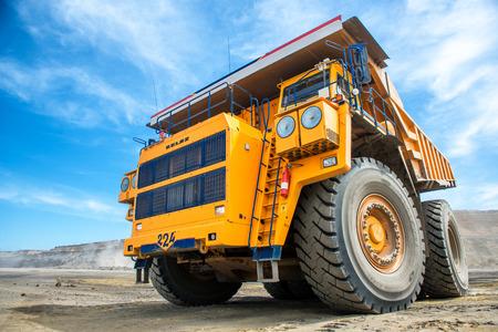 Big yellow mining truck earthmoving in Russia.