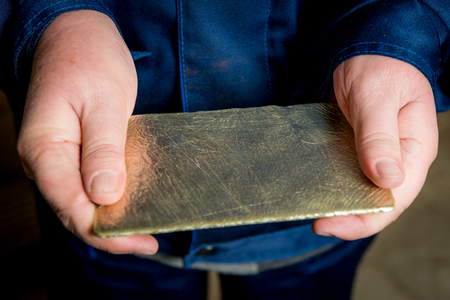 made russia: Just made gold ingot in the hands, Russia.