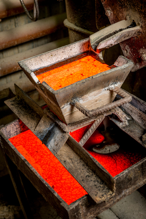 smelting plant: Siberia, Russia - August 13, 2014: moulting gold