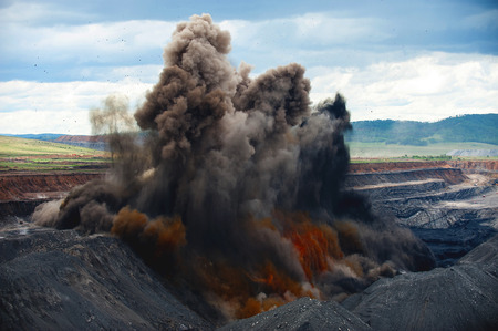 Explosive works on a coal mine at the career in Russia. Stock Photo
