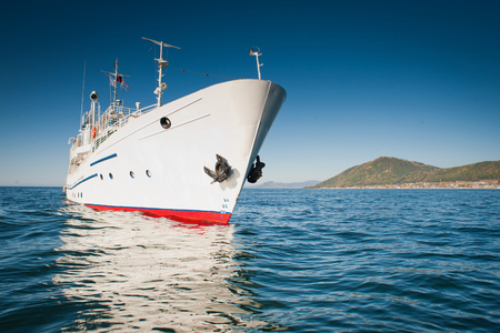 nouse: White ship in the waters of lake Baikal in the summer time