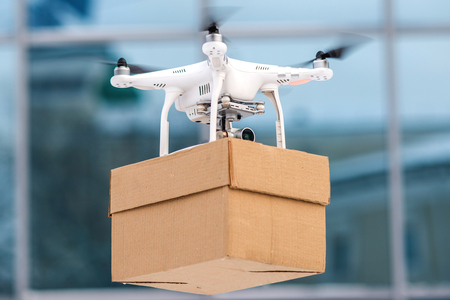 deliver: Drone is a great tool for delivering packages. Stock Photo