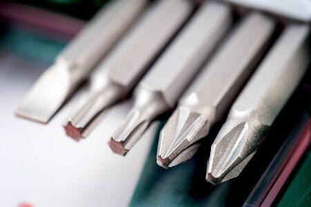 A set of various screwdriver bits in a toolbox