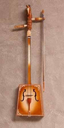 souvenir traditional: Souvenir. Wooden layout traditional Mongolian musical instrument Stock Photo