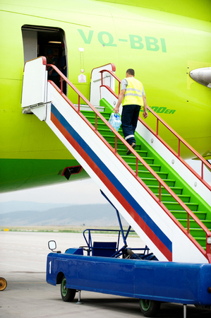 gangway: Some gangway of the plane at the airport Baikal in Russia
