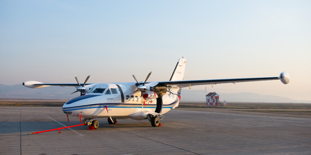 let: Ulan-Ude, Russia - April 22, 2014: New white Let 410 airplane parked at the airport Baikal.